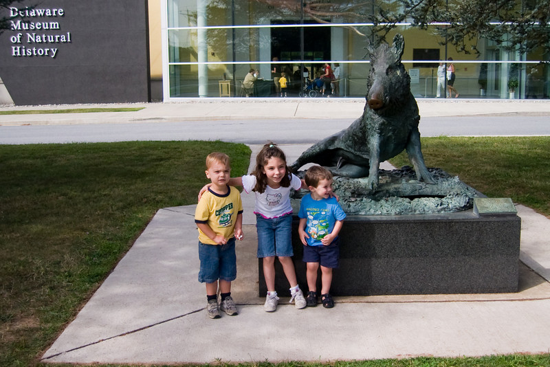 KC visited the museum with his friends Katie and Robbie.
