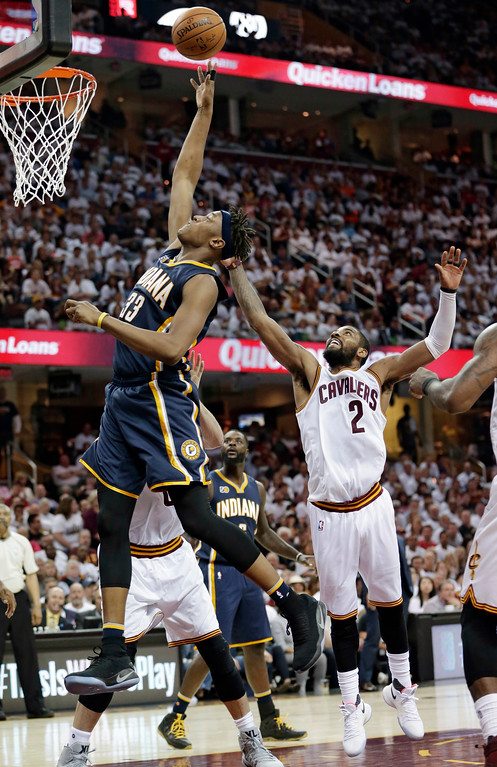 . Indiana Pacers\' Myles Turner (33) drives to the basket against Cleveland Cavaliers\' Kyrie Irving (2) in the second half in Game 1 of a first-round NBA basketball playoff series, Saturday, April 15, 2017, in Cleveland. The Cavaliers won 109-108. (AP Photo/Tony Dejak)