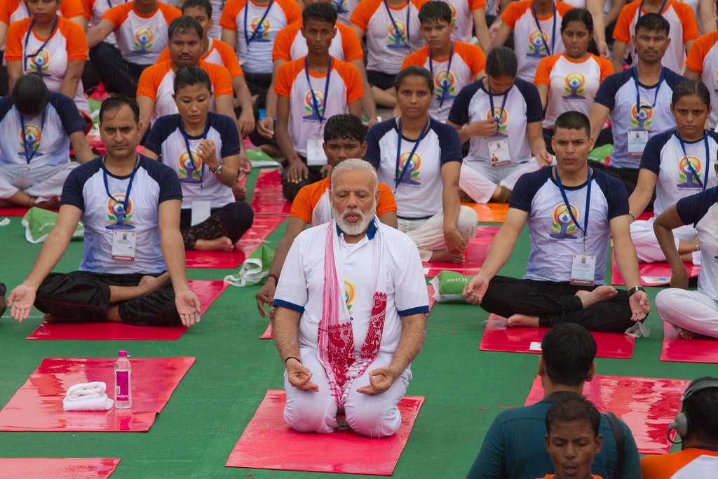 . Indian Prime Minister Narendra Modi, center, performs yoga with thousands of Indians to mark international yoga day in Lucknow, India, Wednesday, June 21, 2017. Millions of yoga enthusiasts across India take part in a mass yoga sessions to mark the third International Yoga Day which falls on June 21 every year. (AP Photo/Rajesh Kumar Singh)