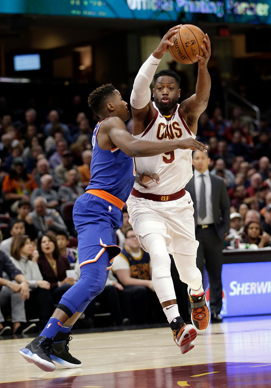 . Cleveland Cavaliers\' Dwyane Wade, right, drives past New York Knicks\' Frank Ntilikina, from France, in the first half of an NBA basketball game, Sunday, Oct. 29, 2017, in Cleveland. (AP Photo/Tony Dejak)