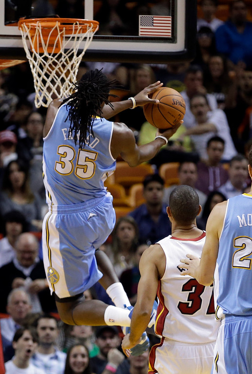 . Denver Nuggets forward Kenneth Faried (35) goes to the basket against the Miami Heat during the first half of an NBA basketball game in Miami, Friday, March 14, 2014. (AP Photo/Alan Diaz)