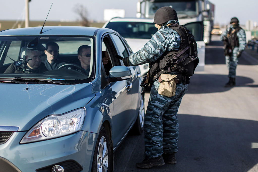 . A pro-Russian serviceman checks a car at Chongar checkpoint blocking the entrance to Crimea on March 10, 2014. Russia vowed on March 10 to unveil its own solution to the Ukrainian crisis that would run counter to US efforts and would appear to leave room for Crimea to switch over to Kremlin rule. The unexpected announcement came as Ukraine\'s new pro-European leaders raced to rally Western support in the face of the seizure by Kremlin-backed forces of the strategic Black Sea peninsula and plans to hold a Sunday referendum on switching Crimea\'s allegiance from Kiev to Moscow. ALISA BOROVIKOVA/AFP/Getty Images