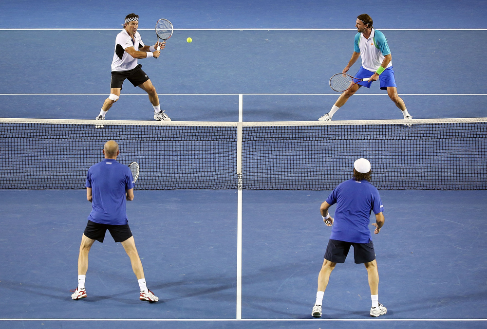 Description of . Pat Cash of Australia hits a backhand volley during his legends doubles match with Goran Ivanisevic of Croatia against Henry Leconte and Guy Forget of France during the 2013 Australian Open at Melbourne Park on January 24, 2013 in Melbourne, Australia.  (Photo by Michael Dodge/Getty Images)