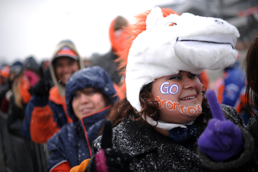 . Lesley Hernandez, front, and Denver Broncos fans are in the United in Orange Pep Rally at Sports Authority Field at Mile High in Denver on Friday. Denver. CO, January 11, 2013.  Hyoung Chang, The Denver Post