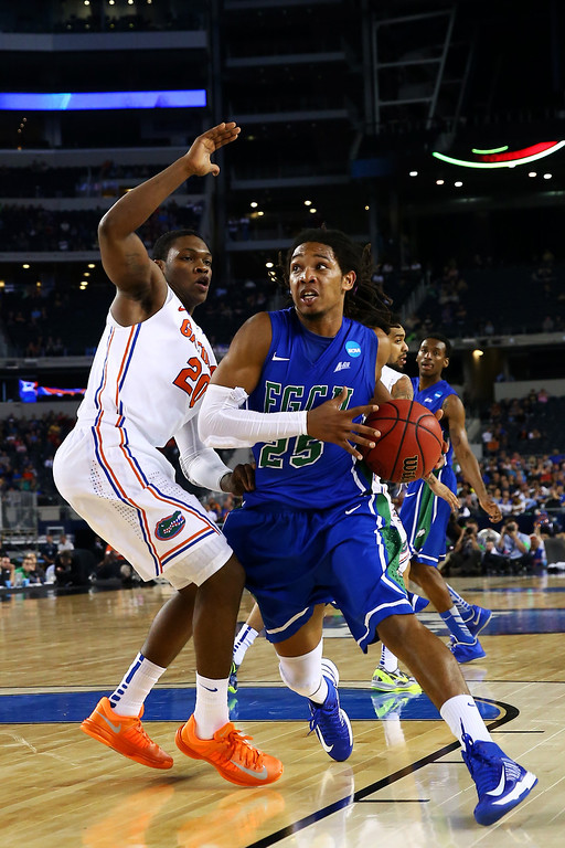 . ARLINGTON, TX - MARCH 29:  Sherwood Brown #25 of the Florida Gulf Coast Eagles drives against Michael Frazier II #20 of the Florida Gators in the second half during the South Regional Semifinal round of the 2013 NCAA Men\'s Basketball Tournament at Dallas Cowboys Stadium on March 29, 2013 in Arlington, Texas.  (Photo by Tom Pennington/Getty Images)