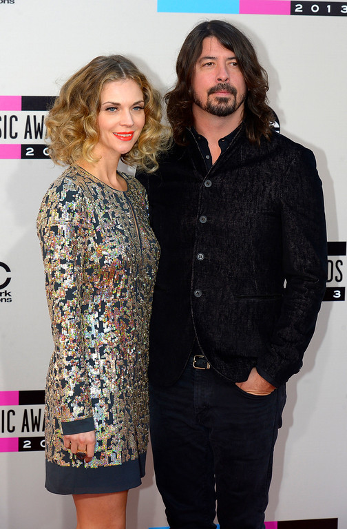 . Dave Grohl and Jordyn Blum arrives to the American Music Awards  at the Nokia Theatre in Los Angeles, California on Sunday November 24, 2013 (Photo by Andy Holzman / Los Angeles Daily News)