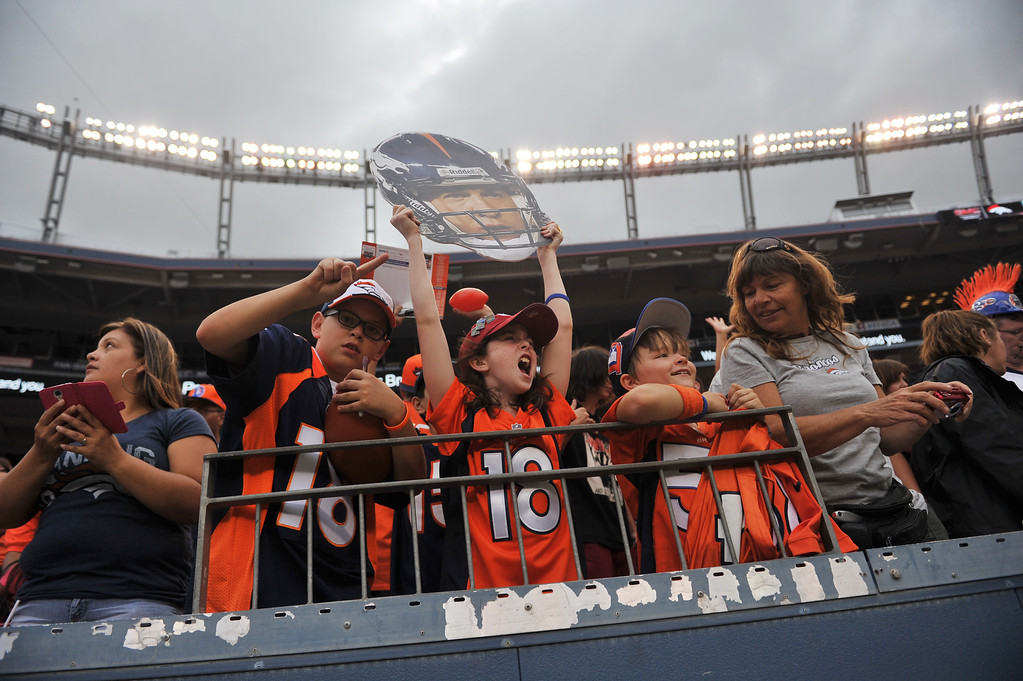 . DENVER, CO. - August 03: Sarah Long, 11, of Denver, center, with Payton Manning cutout is in Sports Authority Field at Mile High for summer scrimmage. Denver, Colorado. August 03, 2013. (Photo By Hyoung Chang/The Denver Post)