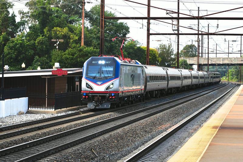 Amtrak's train 97 blows through Odenton, led by shiny new ACS-64 #607.