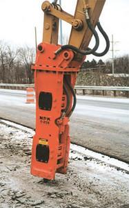 NPK E208 hydraulic hammer on Cat excavator - road construction at 83 & I-71 in Strongsville 12-15-00 (16).jpg