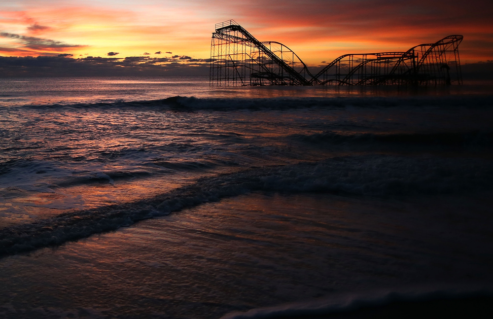 Description of . A roller coaster sits in the ocean after the Casino Pier collapsed when Superstorm Sandy hit, on November 25, 2012 in Seaside Heights, New Jersey. Mayor Bill Akers has asked the Coast Guard to find out whether the coaster is structurally stable, adding that it would make a great tourist attraction.  (Photo by Mark Wilson/Getty Images)