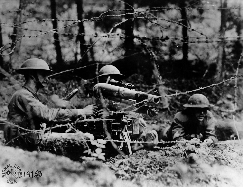 . 26th June 1918:  American soldiers manning a French \'37\', a one-pounder in firing position behind barbed wire in a second line trench at Dieffmatten, in Alsace.  (Photo by Allen H. Hanson/Hulton Archive/Getty Images)