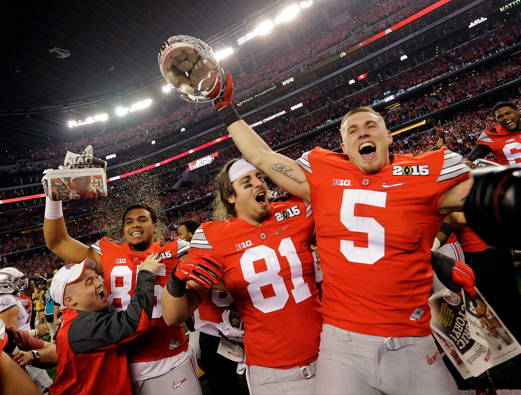 . Ohio State\'s Braxton Miller (5) and Nick Vannett (81) celebrate after the NCAA college football playoff championship game against Oregon Monday, Jan. 12, 2015, in Arlington, Texas. Ohio State won 42-20. (AP Photo/Eric Gay)