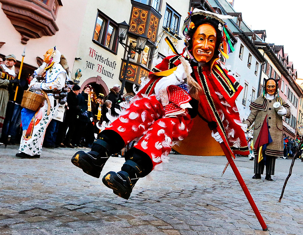 . A young \'Federahannes\', a jester figure from Rottweil, is participating in the \'Narrensprung\' (jester jump) parade in Rottweil, southern Germany, Monday, Feb. 27, 2016. About 4000 jesters paraded through the city among thousands of spectators. The Rottweil Narrensprung is the highlight of the Swabian-Alemannic Fastnacht and one of the traditional pre-Lenten carnival parades in the southwestern Germany. (AP Photo/Michael Probst)