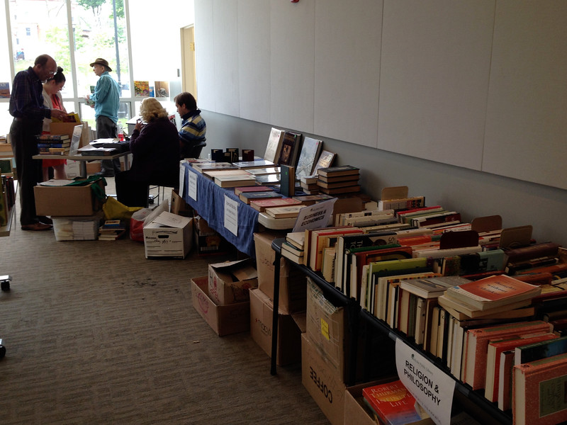 Saturday afternoon.  The table with blue table cloth holds specially priced books:  $5, $10, or in a few cases higher prices.  All were offered at 1/2 price in last hour.
