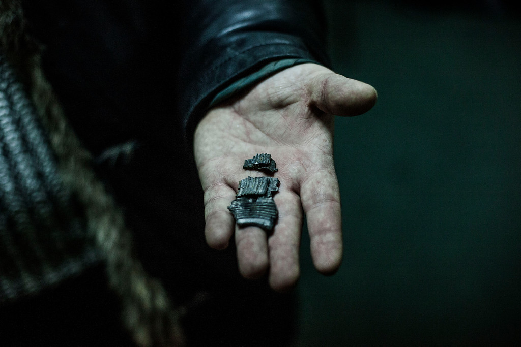 . A Ukrainian man shows a piece of shrapnel at a shelter in Voroshilovsky area, center of Donetsk, Ukraine. Sunday, Jan. 18, 2015. The separatist stronghold, Donetsk, was shaken by intense outgoing and incoming artillery fire as a bitter battle raged for control over the city\'s airport. Streets in the city, which was home to 1 million people before unrest erupted in spring, were completely deserted and the windows of apartments in the center rattled from incessant rocket and mortar fire. (AP Photo/Manu Brabo)