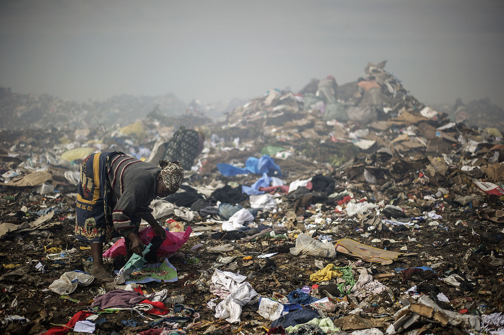 . A woman sifts through garbage at the Maputo municipal garbage dumping site in Maputo on October 14, 2014. GIANLUIGI GUERCIA/AFP/Getty Images