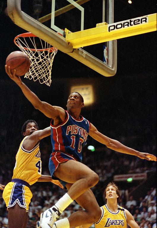 . 27. Dennis Rodman, shown in center (Associated Press file)