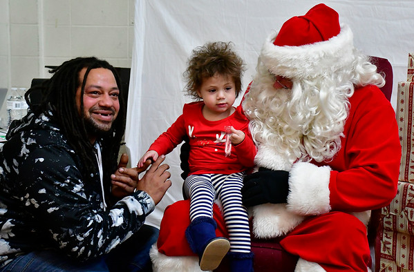 12/8/2018 Mike Orazzi | Staff Nate Gibson and his daughter Addison,2, meet Santa while at the YWCA New Britain Winter Wonderland Saturday in New Britain.