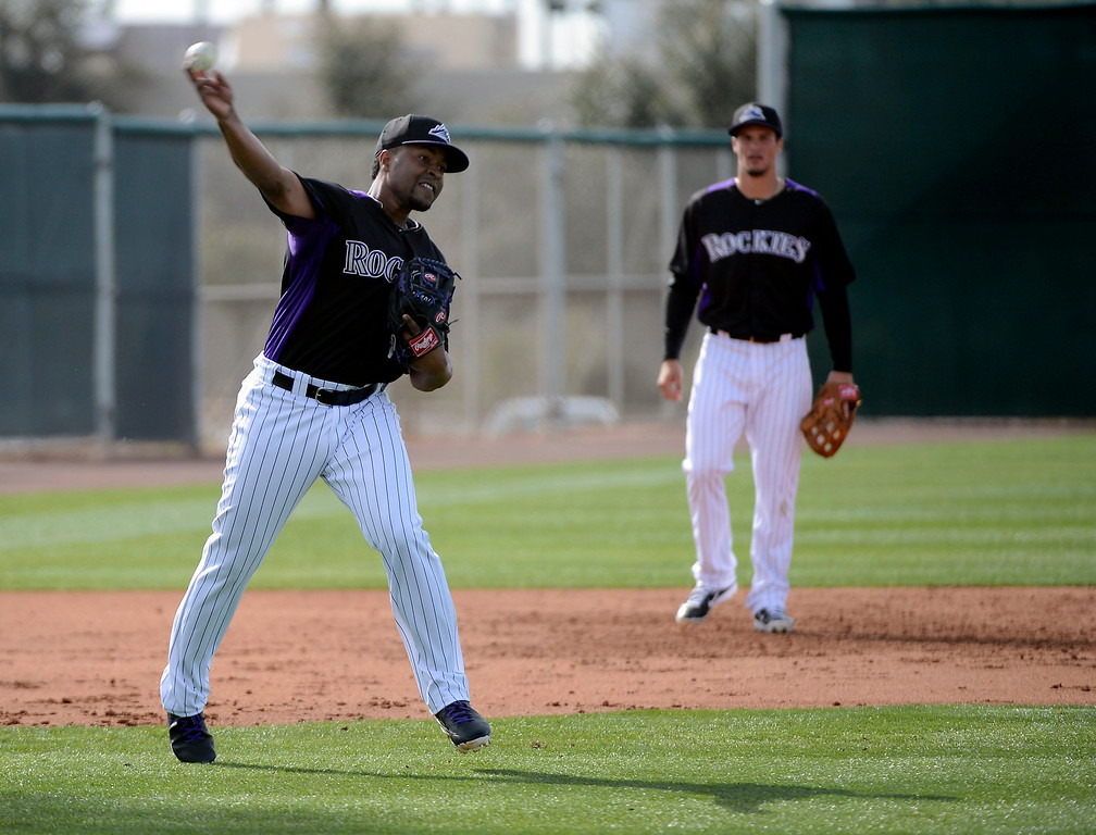 . SCOTTSDALE, AZ. - FEBRUARY 19: Chris Nelson (4) of the Colorado Rockies throws to first after scooping up a grounder during workouts at Spring Training February 19, 2013 in Scottsdale. (Photo By John Leyba/The Denver Post)