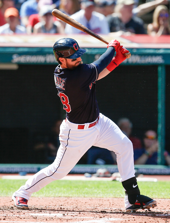 . Cleveland Indians\' Eric Haase hits an RBI single off Detroit Tigers starting pitcher Francisco Liriano during the fourth inning of a baseball game, Sunday, Sept. 16, 2018, in Cleveland. (AP Photo/Ron Schwane)