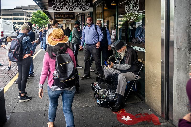 Folk Singer outside the Original Starbucks