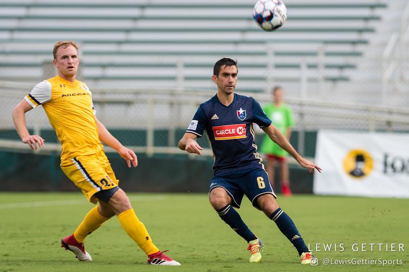 Nashville SC midfielder Matt LaGrassa (20) and North Carolina FC midfielder Austin da Luz (6)