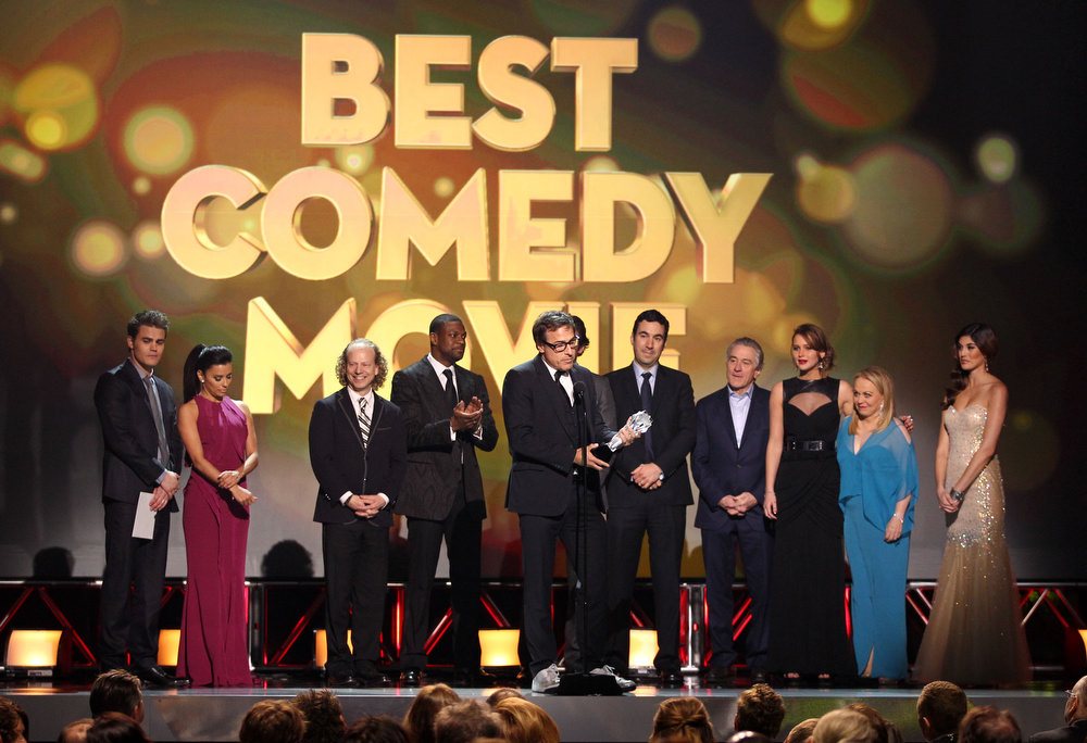 Description of . David O. Russell accepts the award for best comedy movie for