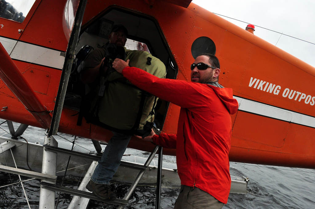 . Harlan Schwartz, co-owner of Red Lake Outfitters in Red Lake, Ont., unloads gear from the Viking Air floatplane taken by Dave Orrick and Steve Safranski to exit Woodland Caribou Provincial Park July 6, 2013. Schwartz and co-owner Matt Long greeted the pair at the end of their six-day trip with cold beer, as they often do with their customers.