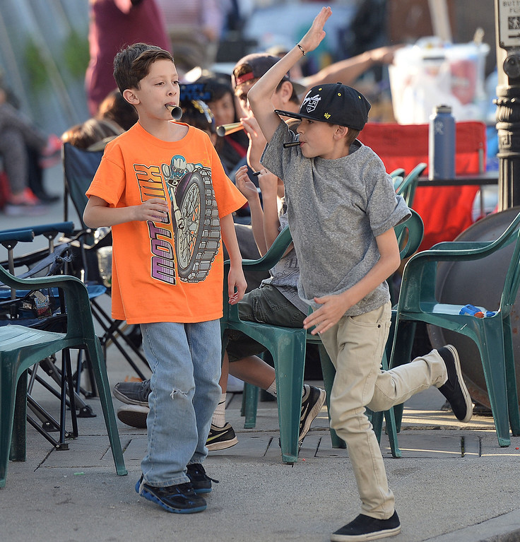 . Nine year-old Jason DeAnda, left, nine year-old Malachi Gisler of Beaumont play horns as families camp out and stake their spots for the Rose Parade along Colorado Boulevard in Pasadena, Calif., on Tuesday, Dec. 29, 2013.     (Keith Birmingham Pasadena Star-News)