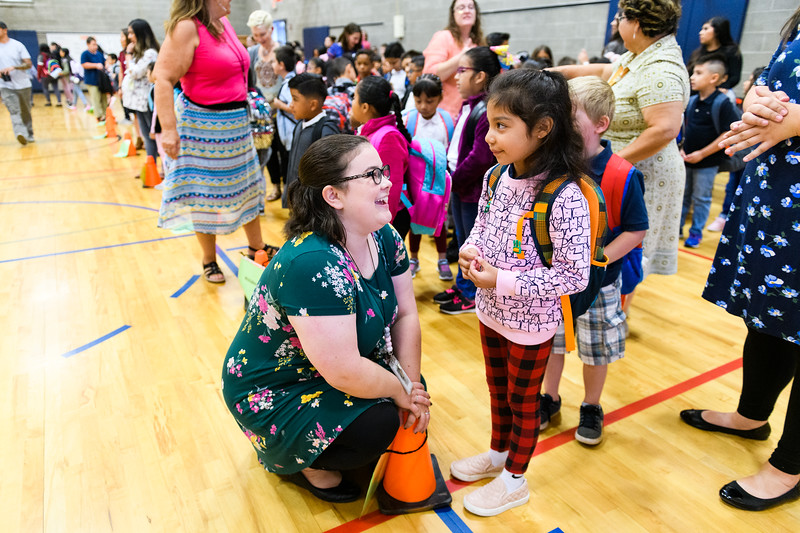 Kindergarten teacher Bryndle Jarvis chats with a student. Back to school day at Hallman Elementary School on Wednesday, September 4, 2019 in Salem, Ore.