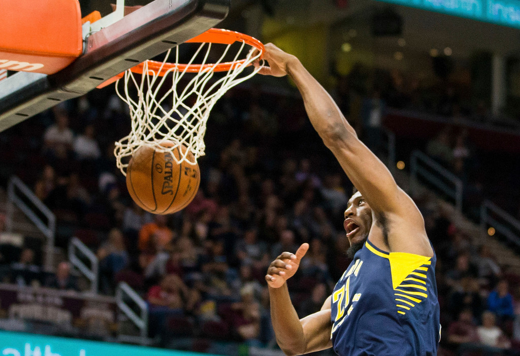 . Indiana Pacers\' Thaddeus Young (21) dunks the ball against the Cleveland Cavaliers during the third quarter of an NBA preseason basketball game, Friday, Oct. 6, 2017, in Cleveland. The Pacers won 106-102. (AP Photo/Scott R. Galvin)