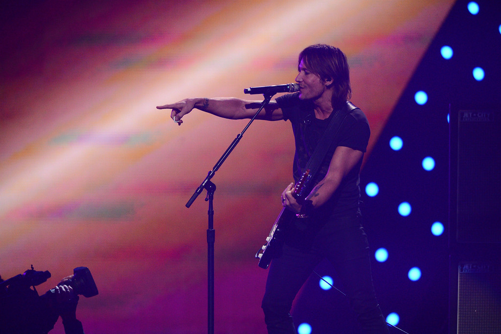 . This Sept. 20, 2013 photo shows Keith Urban performing at the iHeartRadio Music Festival in Las Vegas, Nev. (Photo by Al Powers/Powers Imagery/Invision/AP)