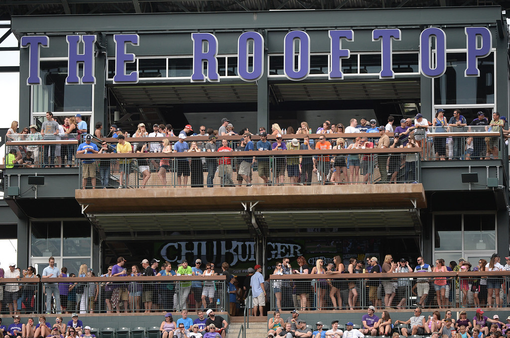. DENVER, CO - JUNE 20: Baseball fans packed the upper level bar at Coors Field Saturday afternoon. The Colorado Rockies hosted the Milwaukee Brewers at Coors Field Saturday afternoon, June 21, 2014. Photo by Karl Gehring/The Denver Post