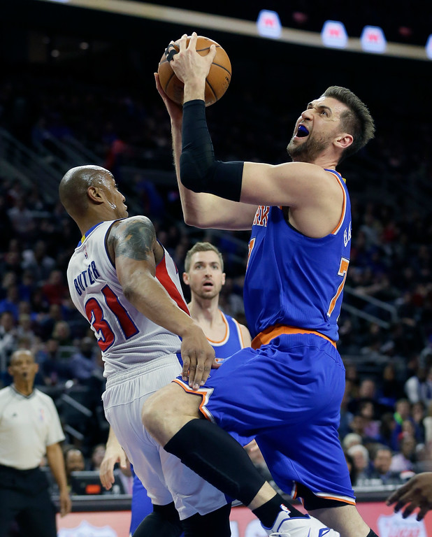 . New York Knicks center Andrea Bargnani (77) drives on Detroit Pistons forward Caron Butler (31) during the first half of an NBA basketball game, Friday, Feb. 27, 2015 in Auburn Hills, Mich. (AP Photo/Carlos Osorio)