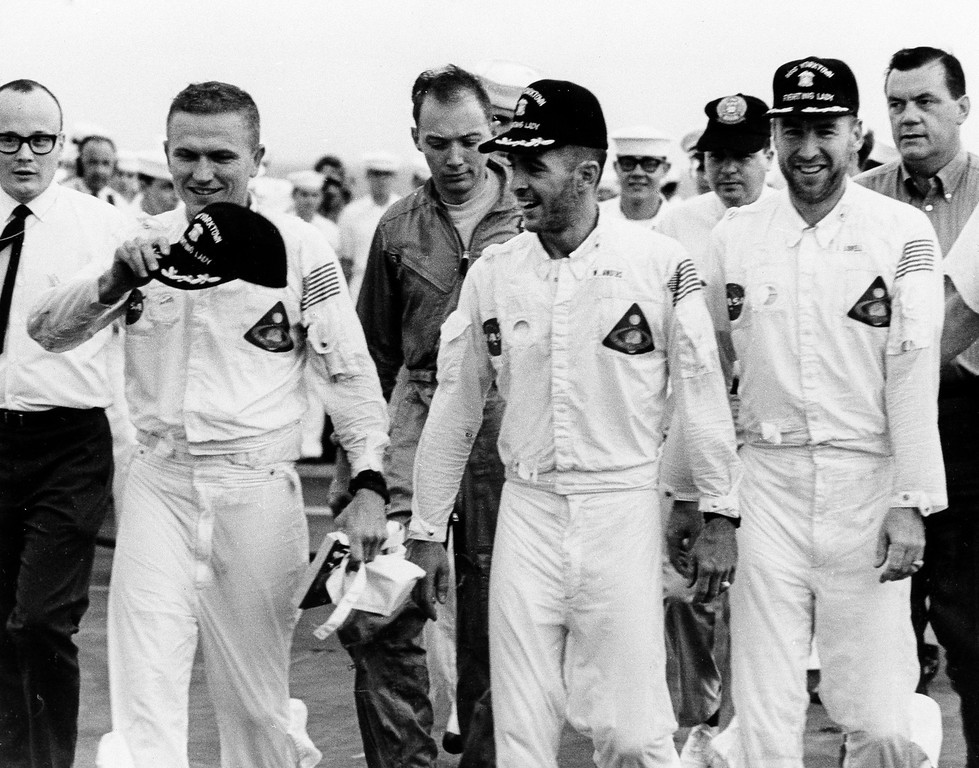 . 1968: The Apollo 8 astronauts. Three happy Apollo 8 astronauts, Frank Borman, left, William A. Anders, center, and James A. Lovell, stroll across the deck of the USS Yorktown after their recovery from the Pacific Ocean, Dec. 28, 1968. The trio just completed a momentous six day flight to the moon and back. (AP Photo/Bob Schultz)