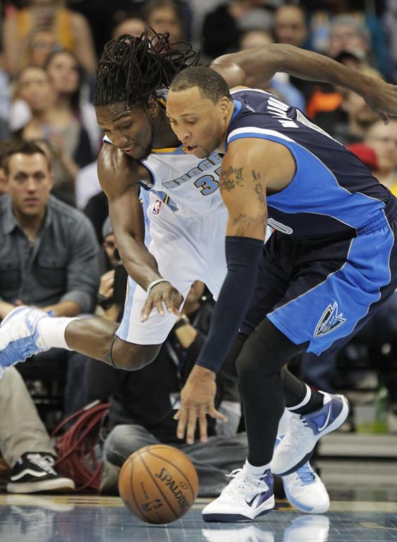 . Denver Nuggets forward Kenneth Faried (35) reaches for a loose ball against Dallas Mavericks forward Shawn Marion (0) during the first quarter of an NBA basketball game in Denver on Saturday, Nov. 23, 2013. (AP Photo/Joe Mahoney)