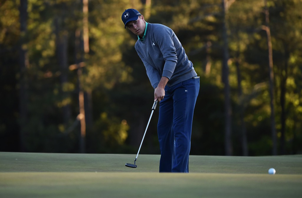 . US golfer Jordan Spieth putts on the 18th green during Round 3 of the 80th Masters Golf Tournament at the Augusta National Golf Club on April 9, 2016, in Augusta, Georgia. / AFP PHOTO / Nicholas KAMM/AFP/Getty Images