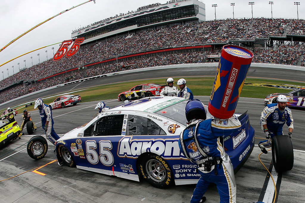 . Mark Martin, driver of the #55 Aaron\'s Dream Machine Toyota, pits  during the NASCAR Sprint Cup Series Daytona 500 at Daytona International Speedway on February 24, 2013 in Daytona Beach, Florida.  (Photo by Chris Graythen/Getty Images)
