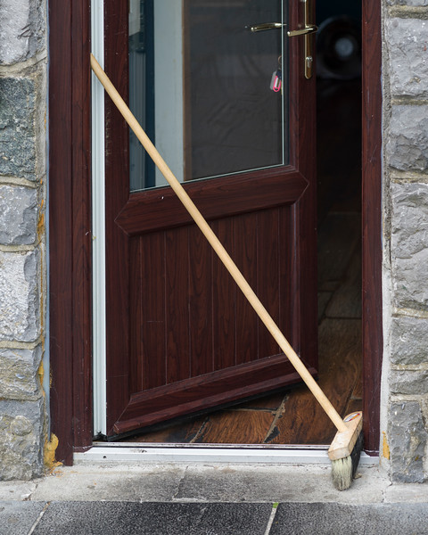 Broom leaning at the entrance of house, Galway, County Galway, Republic of Ireland