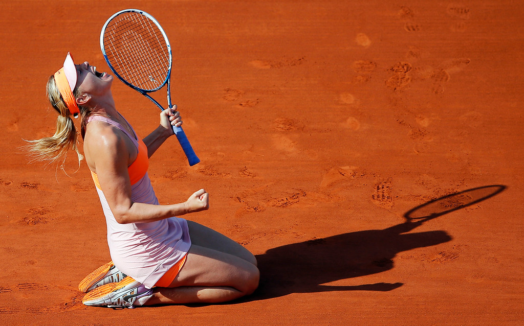 . Russia\'s Maria Sharapova reacts after defeating Romania\'s Simona Halep during their final match of the French Open tennis tournament at the Roland Garros stadium, in Paris, France, Saturday, June 7, 2014. Sharapova won 6-4, 6-7, 6-4. (AP Photo/David Vincent, File)