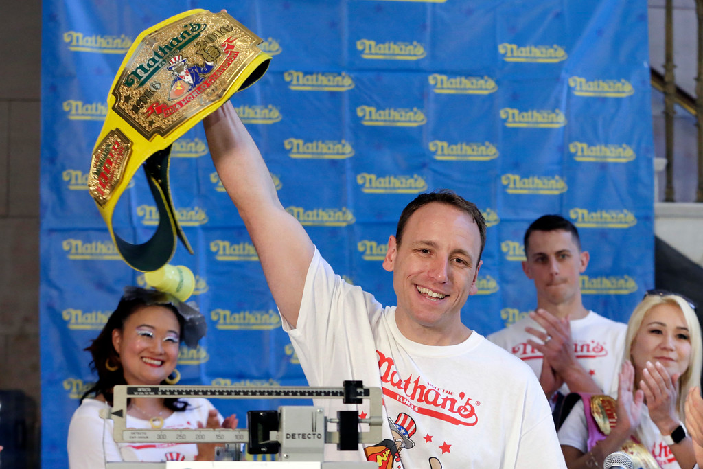 . Eight-time men\'s champion Joey Chestnut, of San Jose, Calif., holds holds his championship belt during the weigh-in for the 2017 Nathan\'s Hot Dog Eating Contest, in Brooklyn Borough Hall, in New York, Monday, July 3, 2017. Chestnut weighed-in at 221.5 pounds. The current women\'s champ, Miki Sudo, of Las Vegas, is at right. (AP Photo/Richard Drew)