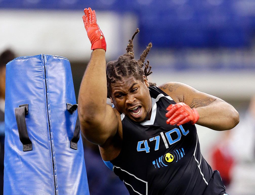 . Arizona State defensive lineman Will Sutton runs a drill at the NFL football scouting combine in Indianapolis, Monday, Feb. 24, 2014. (AP Photo/Michael Conroy)
