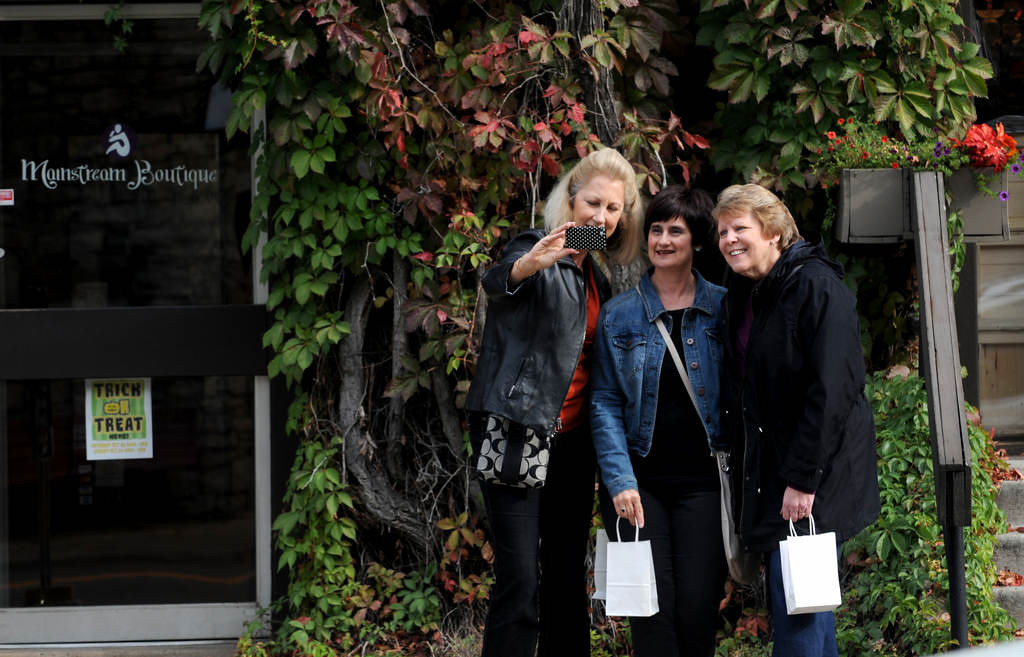 ". Sandy McKown, Elsie Esco and Sue Matz of Minneapolis pose for a picture during a ""friend outing\"" on Main Street in Stillwater in October 2013. (Pioneer Press: Jean Pieri)"