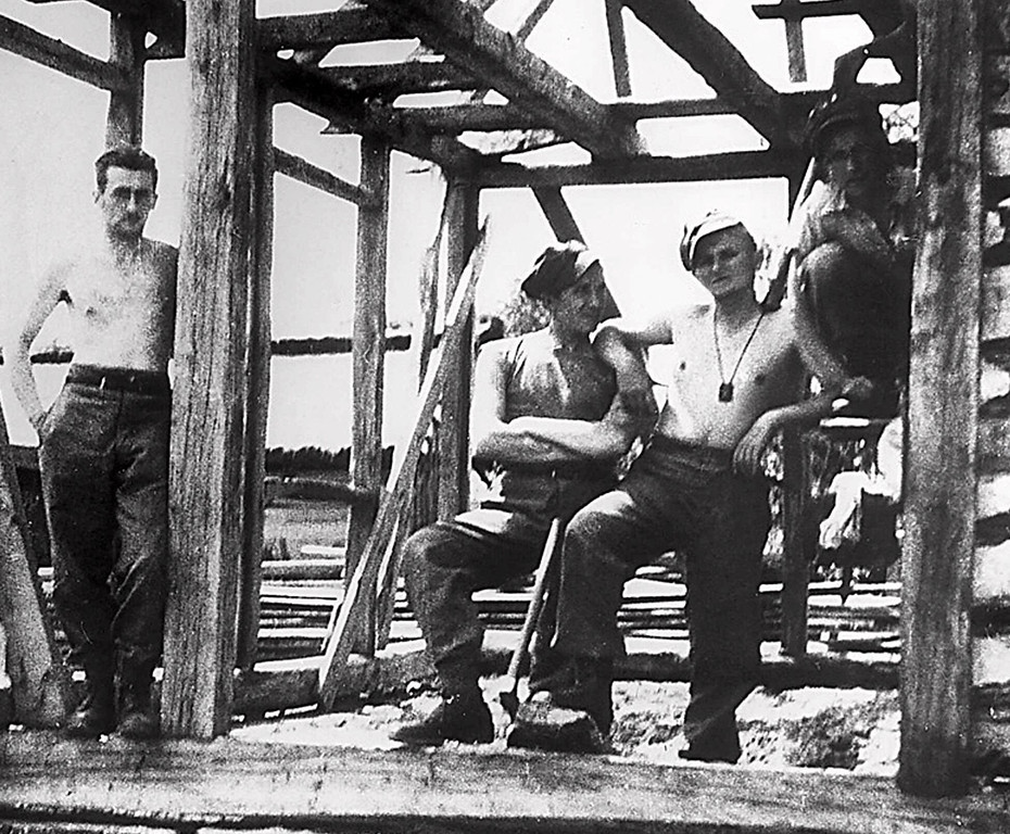 ". In this photo made available Thursday, June 21, 2001 from Italy\'s ""Il Giornale\"" newspaper, a 19-year old Karol Wojtyla, later to become Pope John Paul II, second from right, embraces an unidentified colleague during the construction of a military camp building in July 1939 in Western Ukraine, then eastern Poland. Two months before the outbreak of World War II in Europe, Wojtyla, according to biographers, attended a military training camp in Western Ukraine, then eastern Poland, not far from wherehe will visit during his upcoming pilgrimage to Ukraine starting Saturday, June 23, 2001. (AP Photo/Il Giornale, Adam Gatty-Kostyal)"