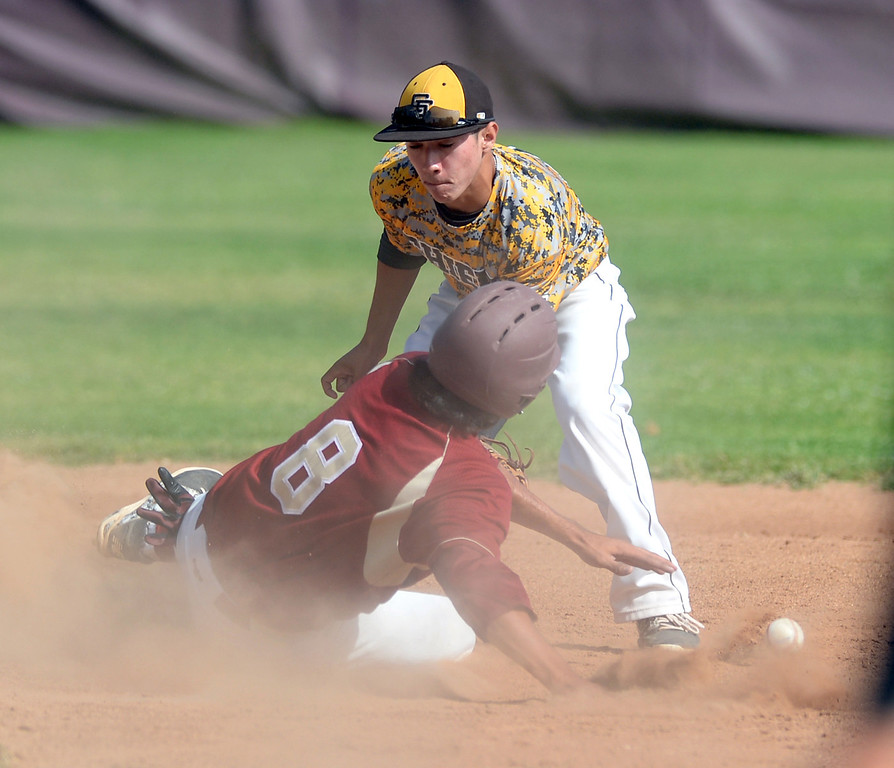 . La Serna\'s Tony Ceron (#8) steals second base as Santa Fe shortstop Anthony Gonzalez (#4) is unable to hold on to the ball in their Del Rio League game at La Serna High School in Whittier on Wednesday April 23, 2014. (Staff Photo by Keith Durflinger/Whittier Daily News)