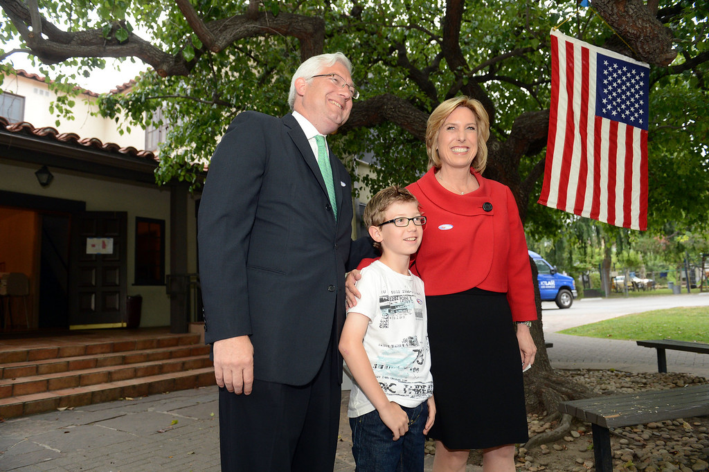 . Los Angeles mayoral candidate Wendy Greuel, husband Dean Schramm and son Thomas Schramm after Greuel cast her ballot at the Universalist Unitarian Church Tuesday, May 21, 2013. (Hans Gutknecht/Los Angeles Daily News)