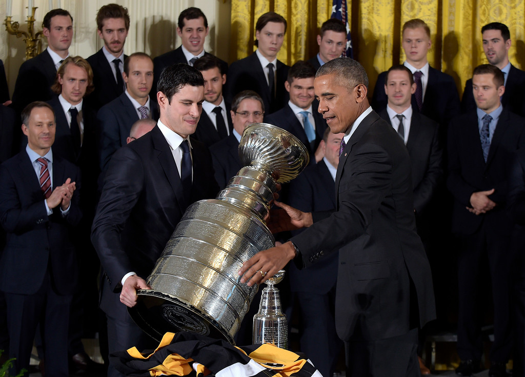 . President Barack Obama and Pittsburgh Penguins captain Sidney Crosby set down the Stanley Cup following a ceremony in the East Room of the White House in Washington, Thursday, Oct. 6, 2016, where the president honored the 2016 Stanley Cup champion Pittsburgh Penguins. (AP Photo/Susan Walsh)