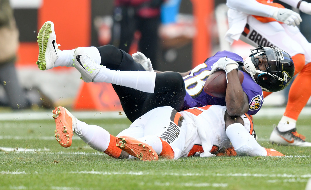 . Baltimore Ravens wide receiver Jeremy Maclin (18) is tackled during the first half of an NFL football game against the Cleveland Browns, Sunday, Dec. 17, 2017, in Cleveland. (AP Photo/David Richard)