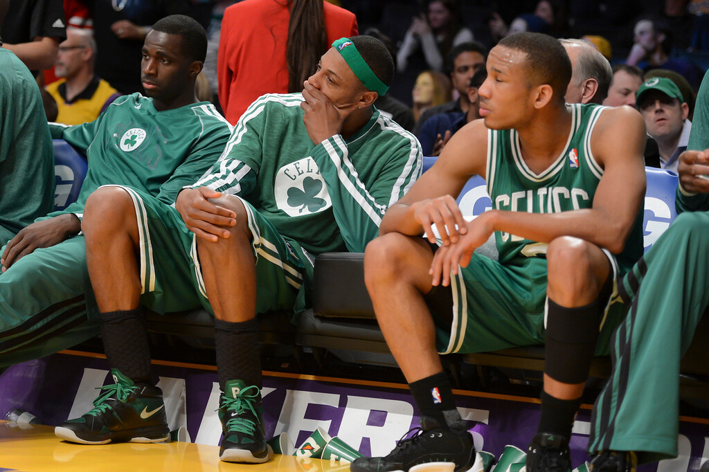 . Celtics\' watch the clock run down as they are defeated by the 113-99.  Photo by David Crane/Staff Photographer