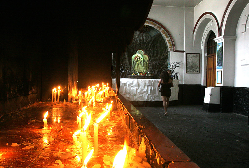 This is one of my favorite images from our trip.  The prayer candles on the left lead your eye to the center of the image where a woman with her child approaches an alter.